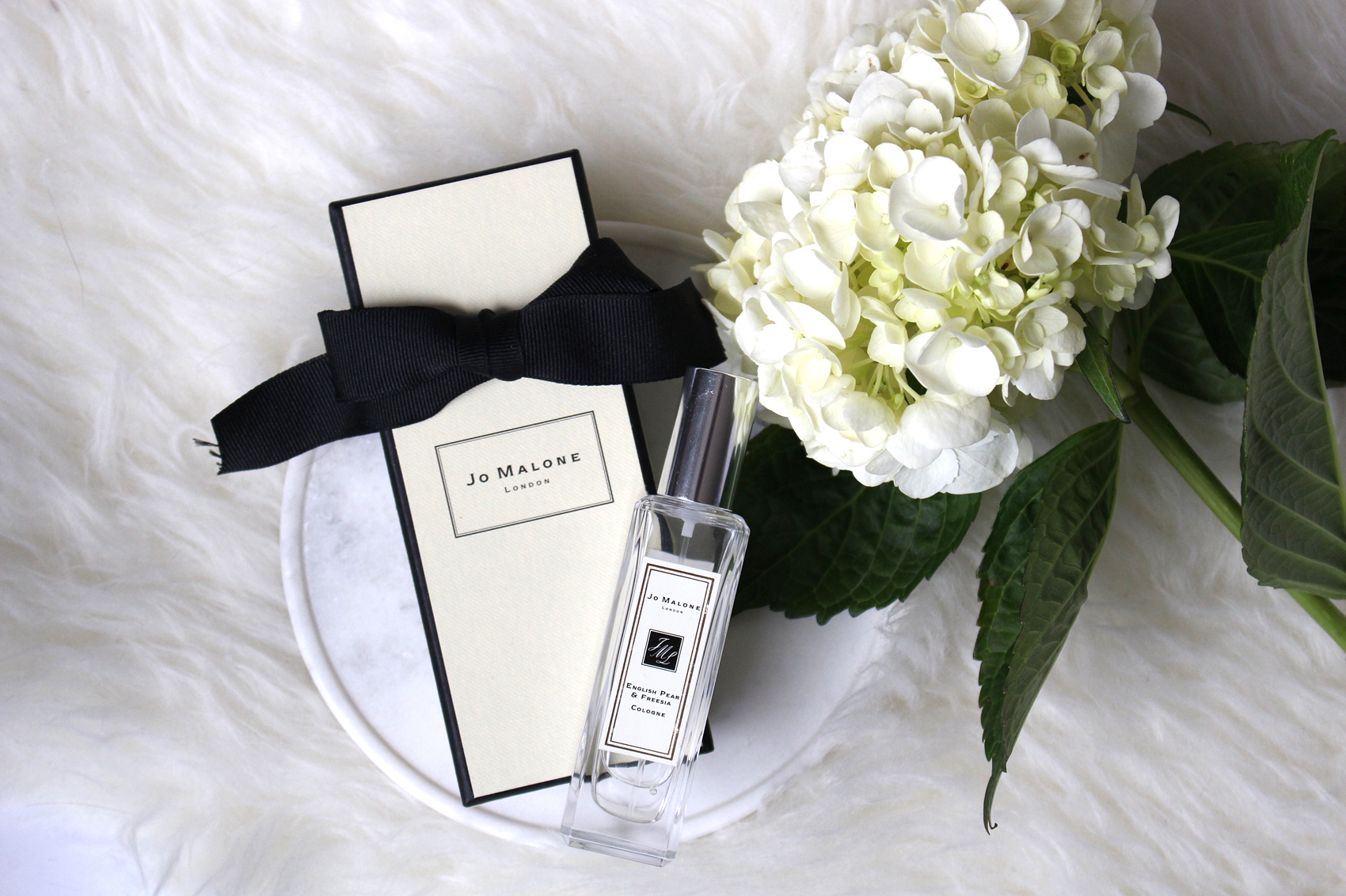 Jo Malone  travel sized cologne in English Pear & Freesia.