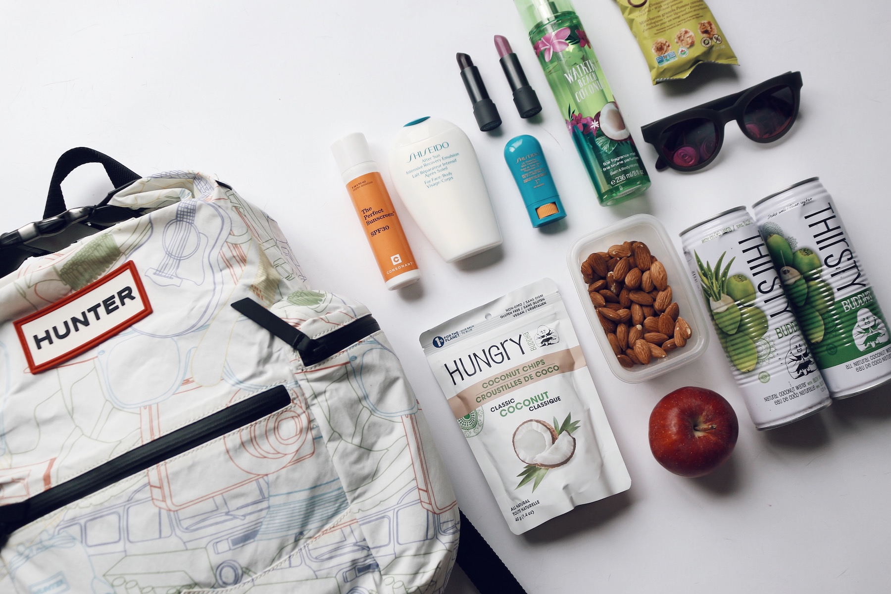 Hunter backpack from SS16 jam packed with my festival essentials including aloe coconut water from  Thirsty Buddha  and coconut chips. I'm obsessed!