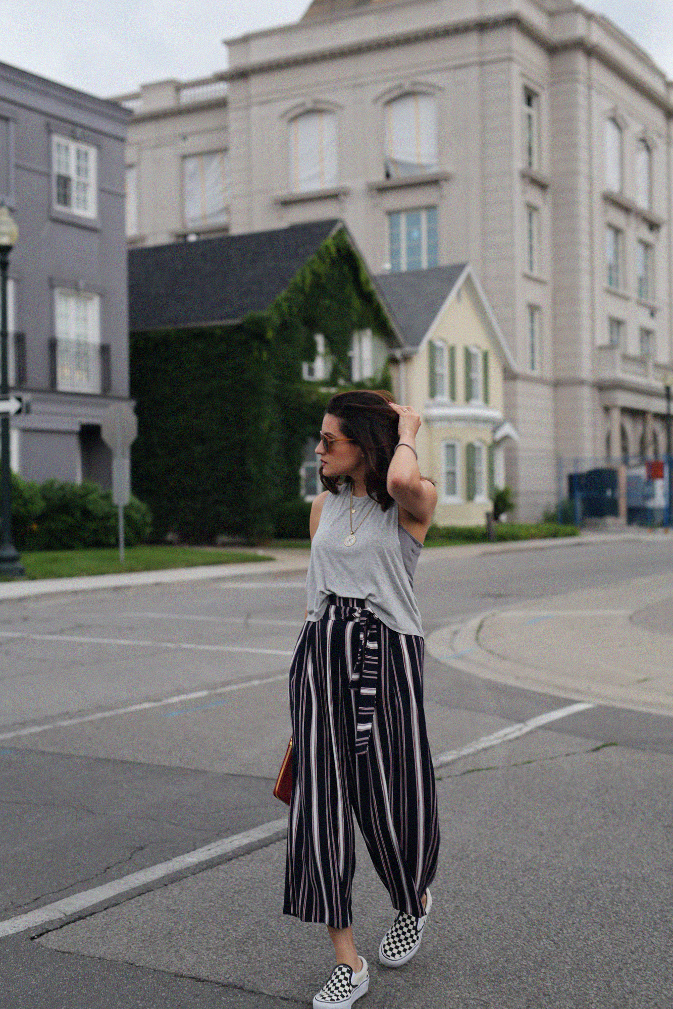 red balenciaga clutch, document holder, checkered vans and striped pants - street style_2029.jpg