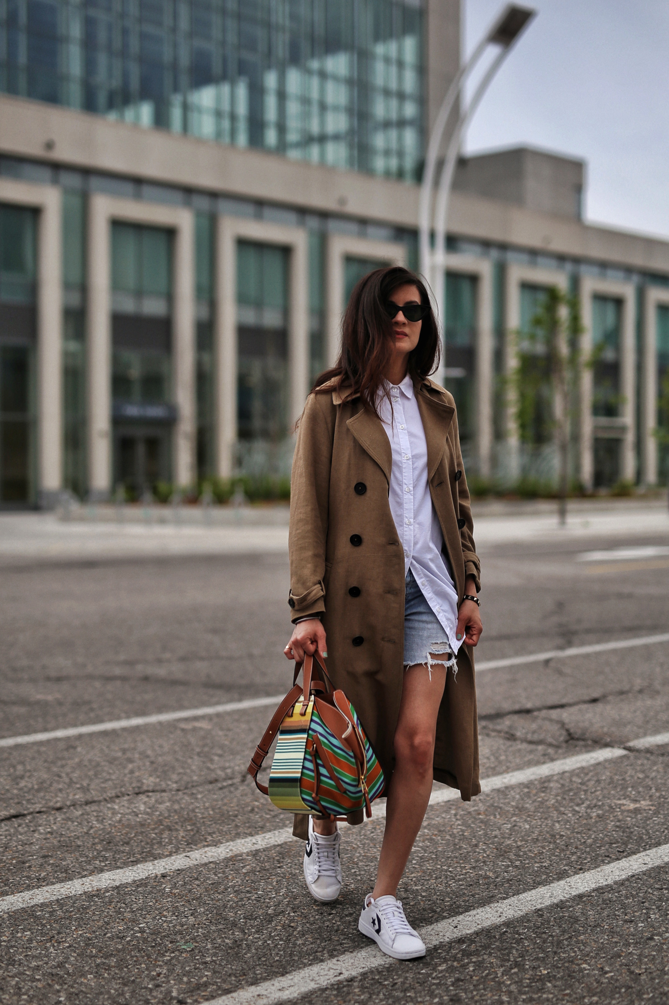 woahstyle.com 2018 - zara linen trench coat, free people cut off shorts, converse one stars, loewe striped small hammock bag, white button up shirt - toronto street style - hotel x - nathalie martin 11.jpg