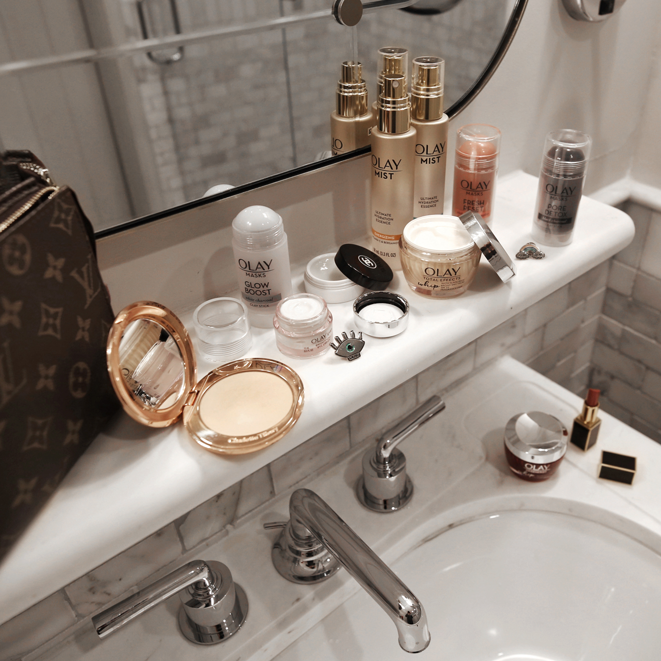 What's on my vanity - Louis Vuitton 19cm clutch, cosmetics bag, Olay Whips, Tom Ford nude lipstick, Olay clay mask, facial mist, bathroom at the Beekman Hotel New York, Nathalie Martin, woahstyle.com.jpg