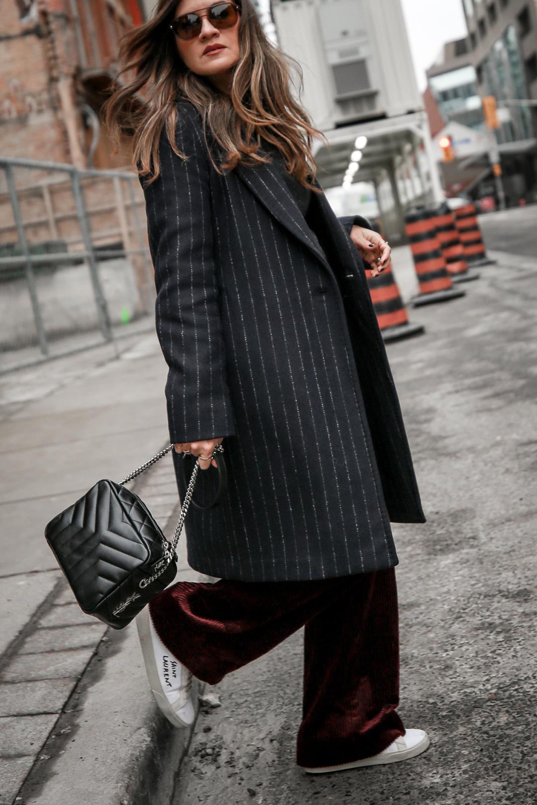 Nathalie Martin Sandro corduroy high waisted pants, Aritzia pinstriped wool Stedman coat, Frank & Oak sweatshirt, Saint Laurent canvas sneakers and small LouLou Bowling Bag, streetstyle, woahstyle.com_4154.jpg