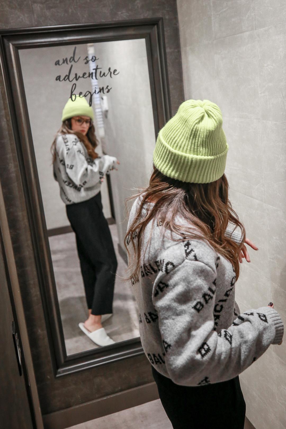 Nathalie Martin wearing Balenciaga logo sweater, Saint Laurent canvas sneakers, and neon green beanie and Bonlook Jerry glasses, streetstyle, woahstyle.com_3830.jpg