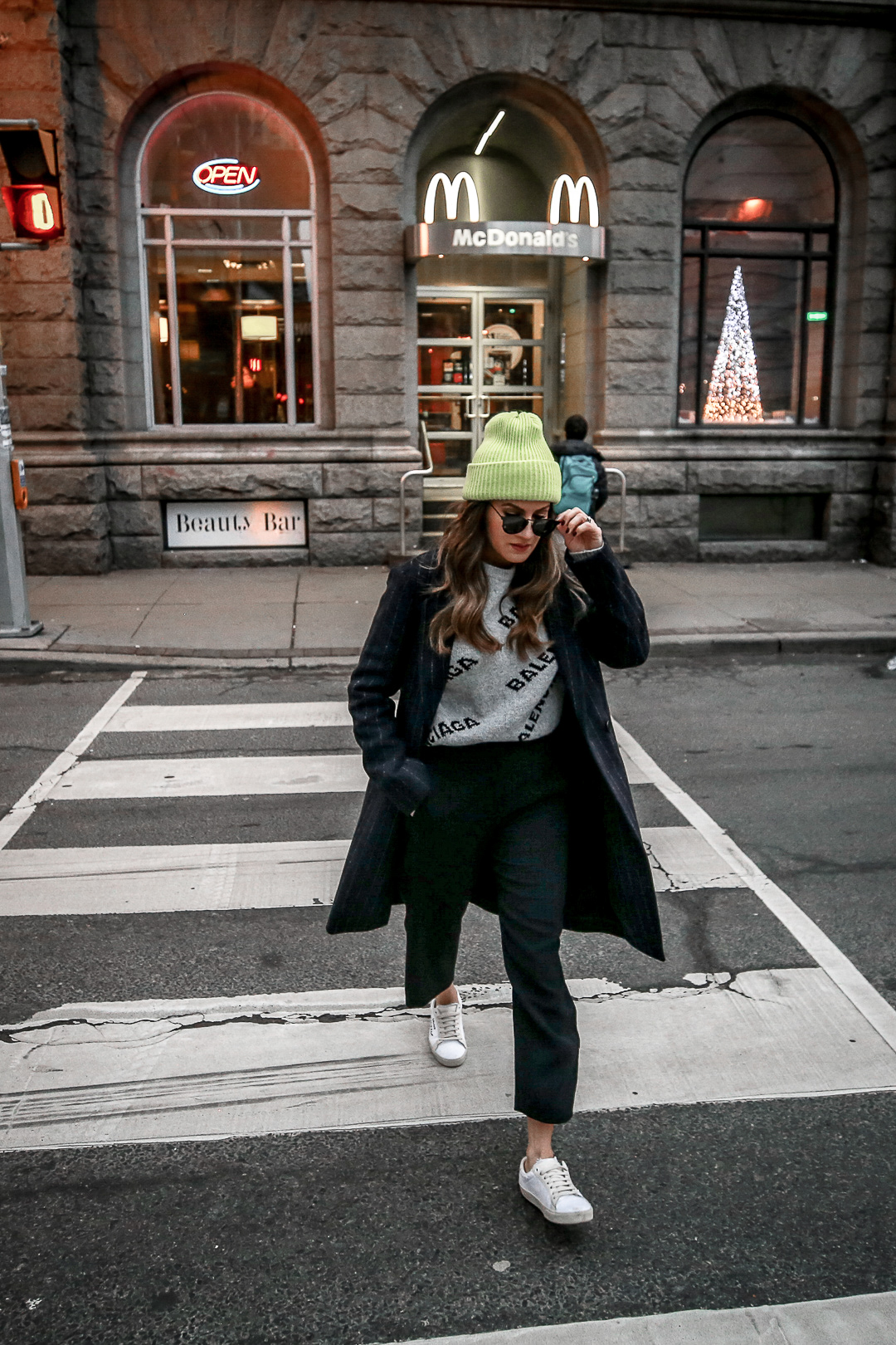 Nathalie Martin wearing Balenciaga logo sweater, Saint Laurent canvas sneakers, Aritzia pinstripe Stedman coat, and neon green beanie and Bonlook Way sunglasses, streetstyle, woahstyle.com_3907.jpg