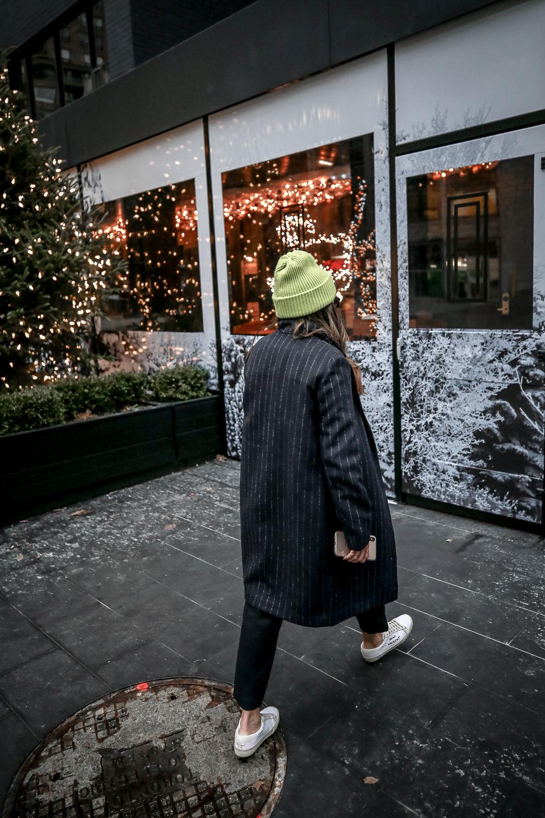 Nathalie Martin wearing Balenciaga logo sweater, Saint Laurent canvas sneakers, Aritzia pinstripe Stedman coat, and neon green beanie and Bonlook Way sunglasses, streetstyle, woahstyle.com_3993.jpg
