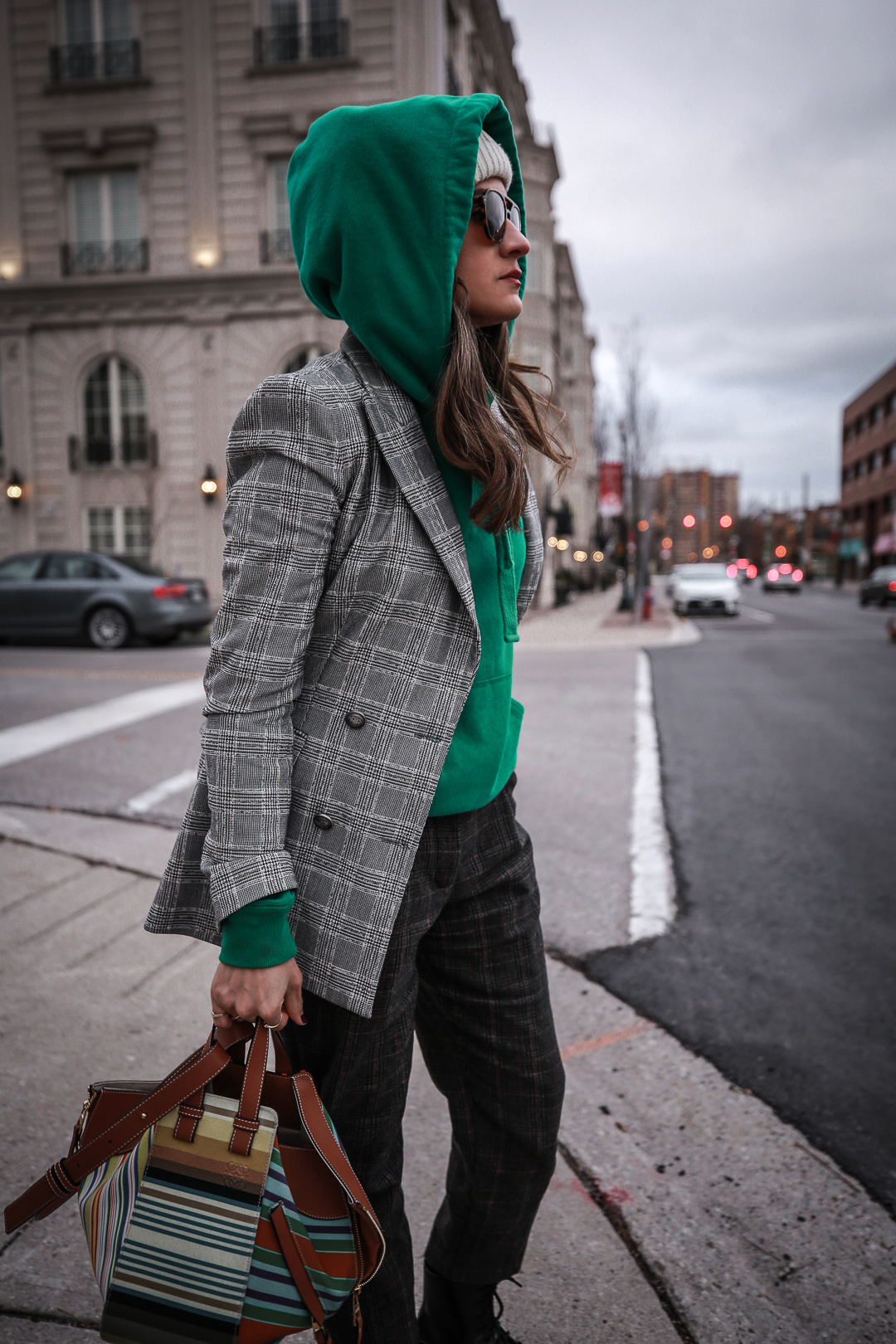 Nathalie Martin wearing plaid blazerk from Zara, green Isabel Marant hoodie, Aritzia wool Chambery pant, Doc Marten boots, striped Loewe hammock bag, Acne Studios ivory Pansy face beanie, woahstyle.com_4746.jpg