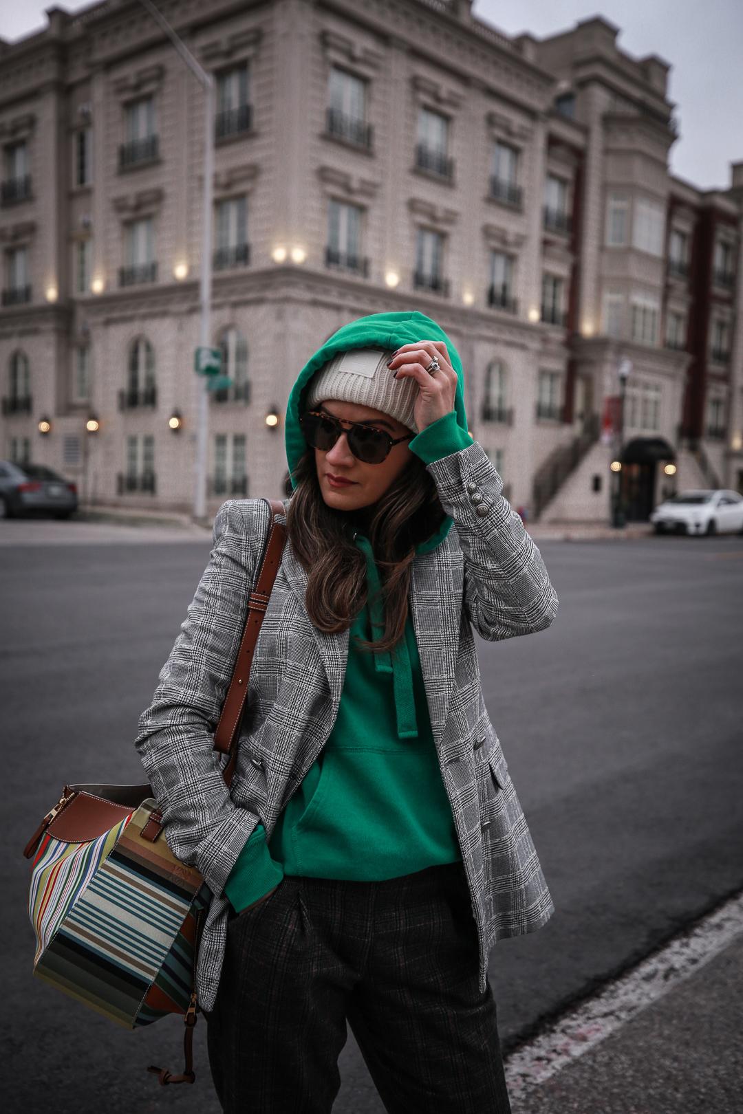 Nathalie Martin wearing plaid blazerk from Zara, green Isabel Marant hoodie, Aritzia wool Chambery pant, Doc Marten boots, striped Loewe hammock bag, Acne Studios ivory Pansy face beanie, woahstyle.com_4763.jpg