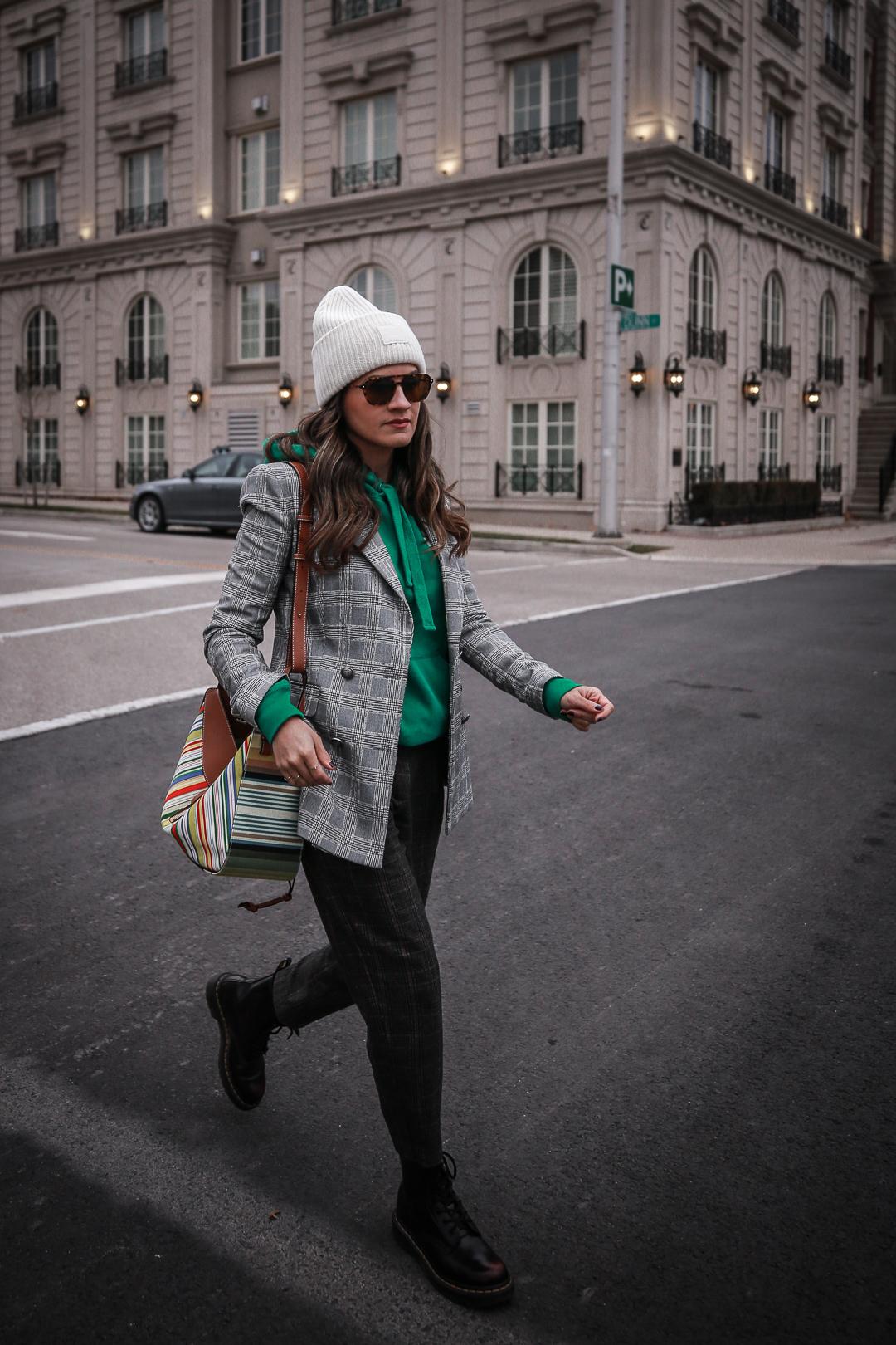 Nathalie Martin wearing plaid blazerk from Zara, green Isabel Marant hoodie, Aritzia wool Chambery pant, Doc Marten boots, striped Loewe hammock bag, Acne Studios ivory Pansy face beanie, woahstyle.com_4712.jpg