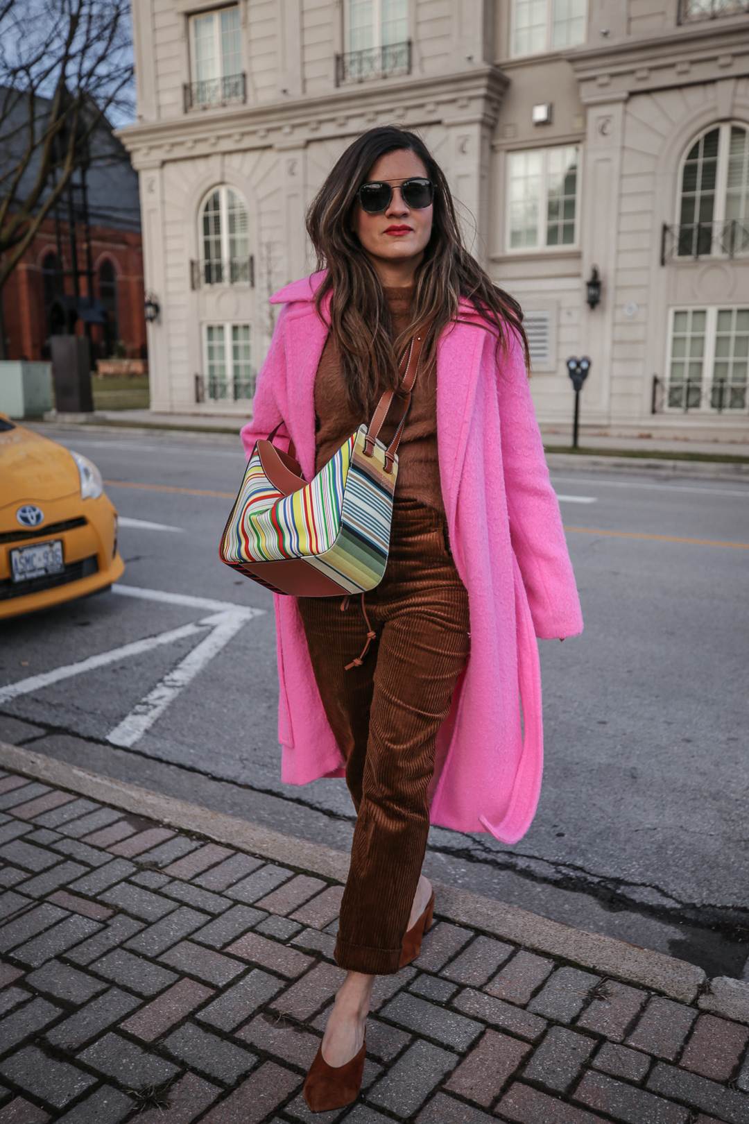 Nathalie Martin wearing Helmut Lang pink belt tie wool coat, brown corduroy pants, Zara brown textured sweater, Prada brown suede mules, Loewe striped Hammock bag, Bonlook Class sunglasses, street style, woahstyle.com_5165.jpg