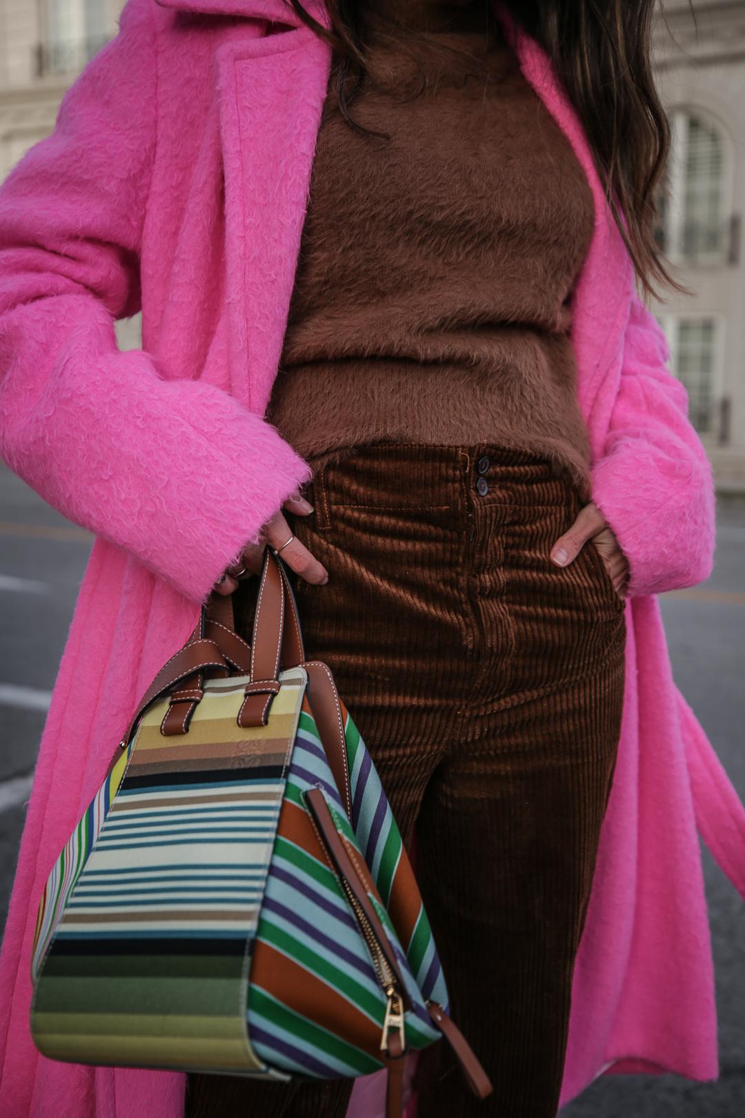 Nathalie Martin wearing Helmut Lang pink belt tie wool coat, brown corduroy pants, Zara brown textured sweater, Prada brown suede mules, Loewe striped Hammock bag, Bonlook Class sunglasses, street style, woahstyle.com_5216.jpg