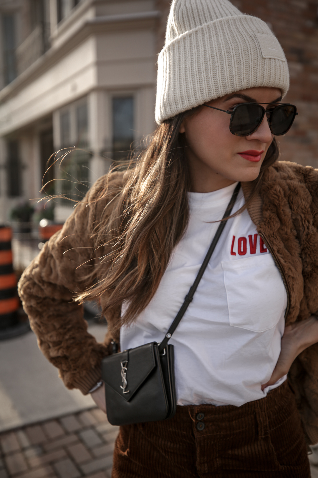 Nathalie Martin wearing brown teddy bear bomber jacket, corduroy pants, Sandro LOVE t-shirt, white sneakers, Saint Laurent Paris black bag, ivory Acne Studios Pansy face beanie, street style, Luka Sabbat inspired, woahstyle.com_4987.jpg