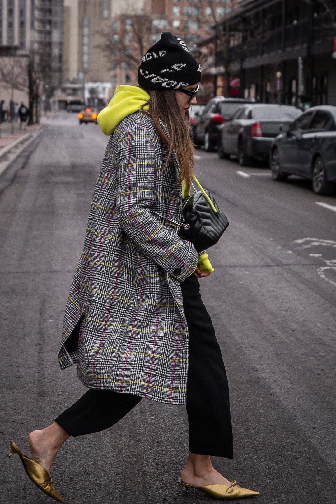 Nathalie Martin - Balenciaga logo beanie hat, Saint Laurent LouLou small bowling bag, Zara neon yellow hoodie, Aritzia Jallade black high waisted pant, Balenciaga bronze leather Knife mules, Dior club 2 sunglasses, street style - WOAHSTYLE.com_5366.jpg