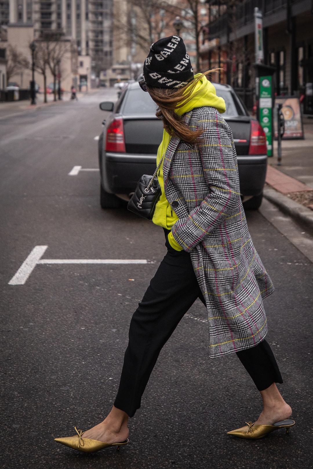 Nathalie Martin - Balenciaga logo beanie hat, Saint Laurent LouLou small bowling bag, Zara neon yellow hoodie, Aritzia Jallade black high waisted pant, Balenciaga bronze leather Knife mules, Dior club 2 sunglasses, street style - WOAHSTYLE.com_5313.jpg