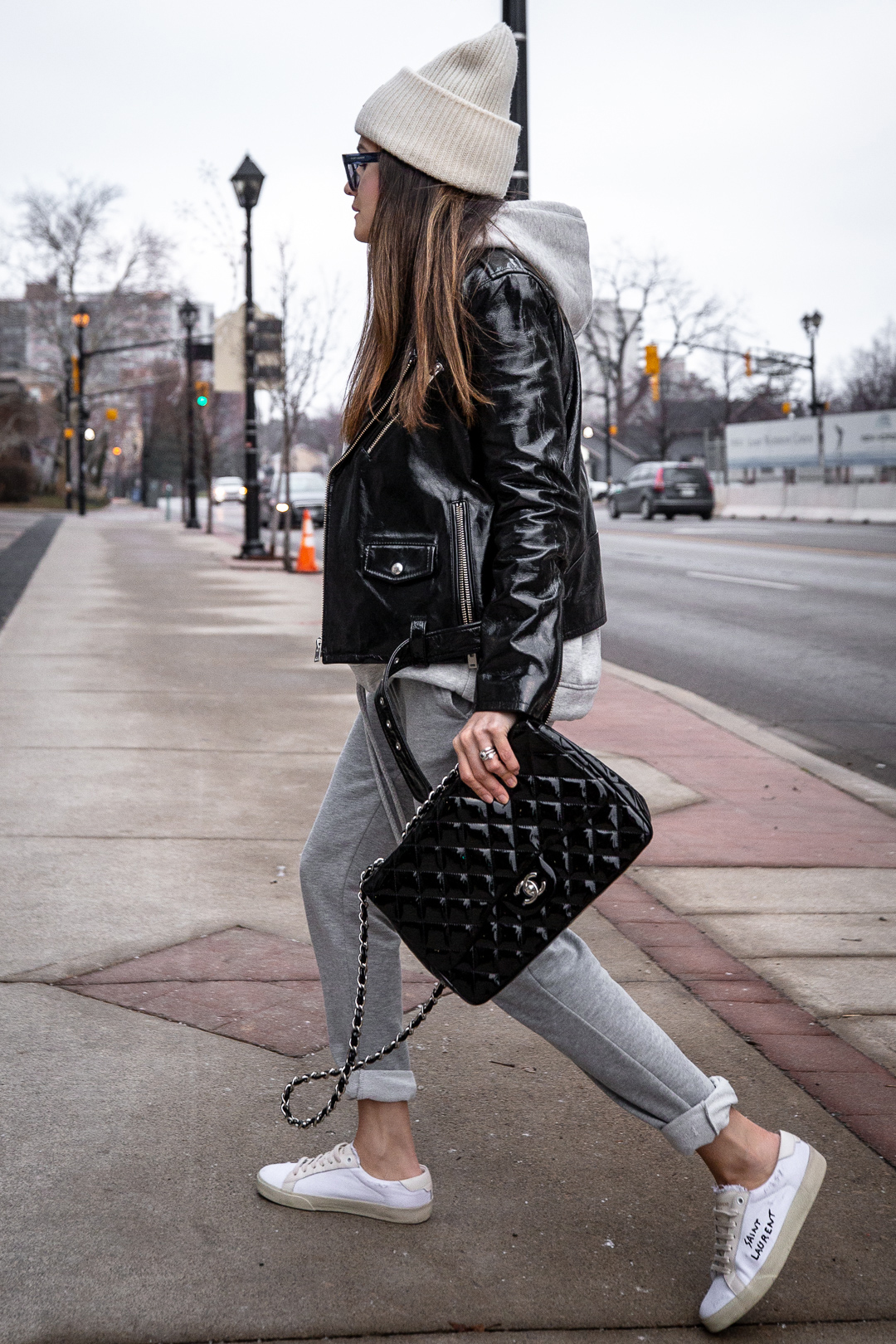 Nathalie Martin - IRO Paris patent leather moto jacket, Zara sweatsuit, grey hoodie and sweatpants, Saint Laurent white canvas logo sneakers, CHANEL patent leather jumbo flap quilted bag, ACNE studios Pansy face beanie hat - woahstyle.com_5548.jpg