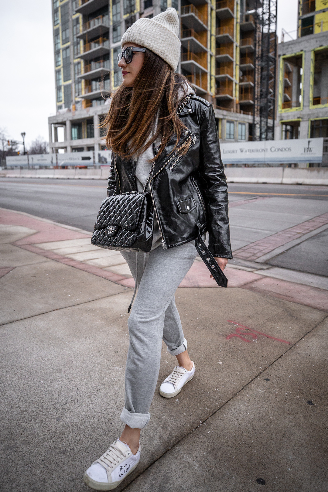 Nathalie Martin - IRO Paris patent leather moto jacket, Zara sweatsuit, grey hoodie and sweatpants, Saint Laurent white canvas logo sneakers, CHANEL patent leather jumbo flap quilted bag, ACNE studios Pansy face beanie hat - woahstyle.com_5538.jpg