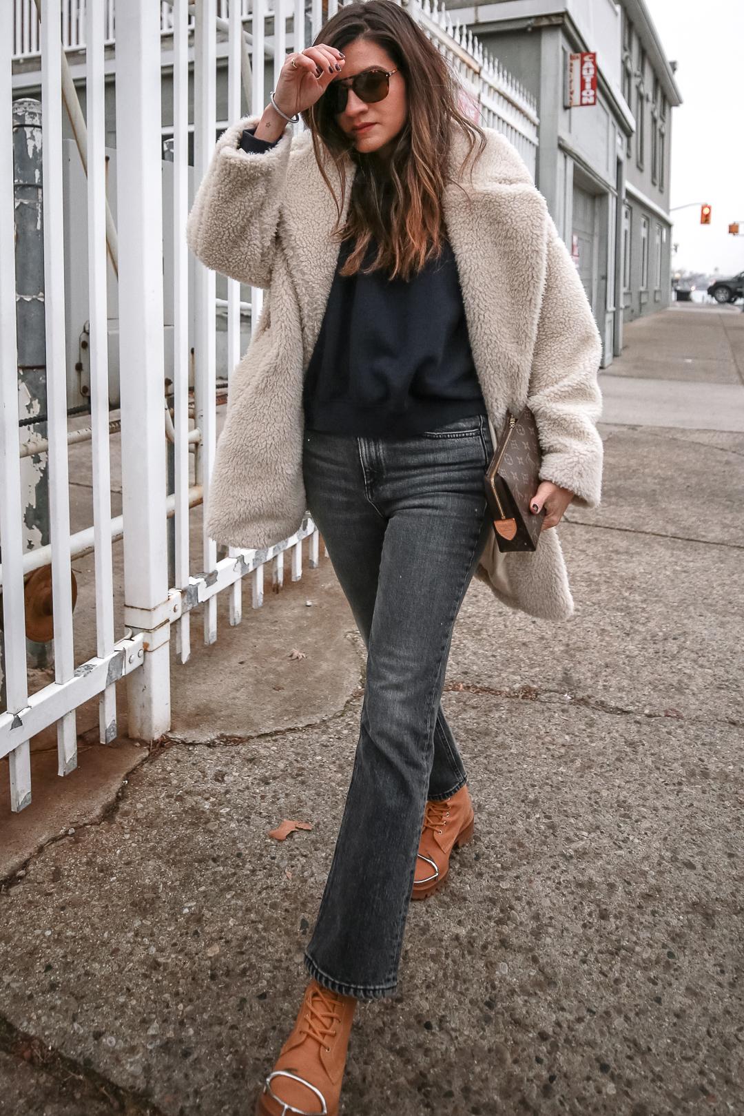 Nathalie Martin - Louis Vuitton Toiletry Pouch clutch 19, navy sweatshirt, Topshop teddy bear coat, Rag & Bone Hana cropped flared jeans, Alexander Wang Lyndon combat boots, casual street style, woahstyle.com_4831.jpg