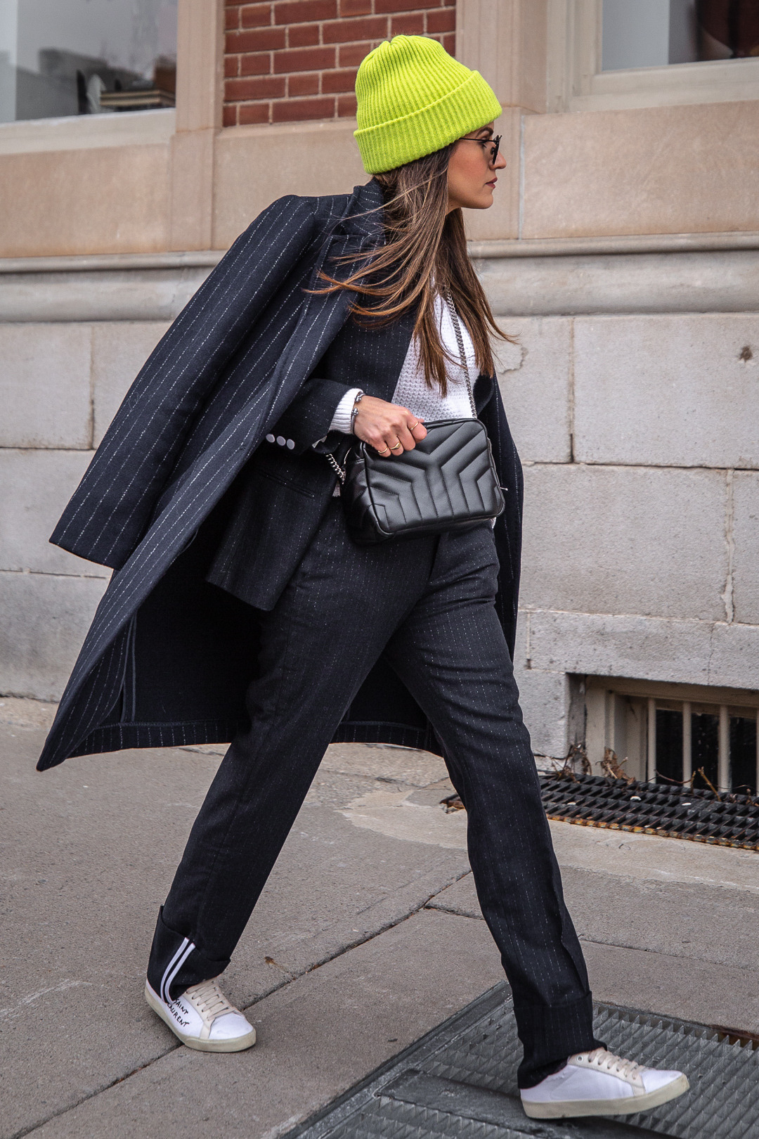 Nathalie Martin - Zadig & Voltaire pinstripe suit, Acne Studios white knitted sweater, Neon green beanie, Saint Laurent LouLou bowling bag and white canvas sneakers, Aritzia Stedman coat, street style, woahstyle.com_5880.jpg