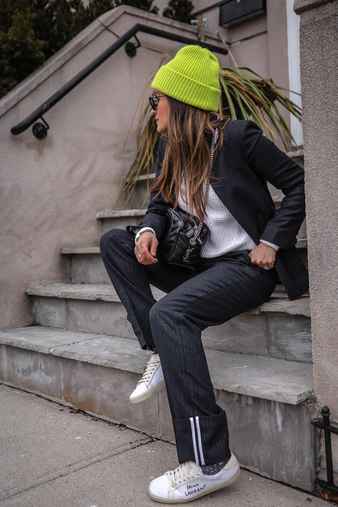 Nathalie Martin - Zadig & Voltaire pinstripe suit, Acne Studios white knitted sweater, Neon green beanie, Saint Laurent LouLou bowling bag and white canvas sneakers, Aritzia Stedman coat, street style, woahstyle.com_5873.jpg
