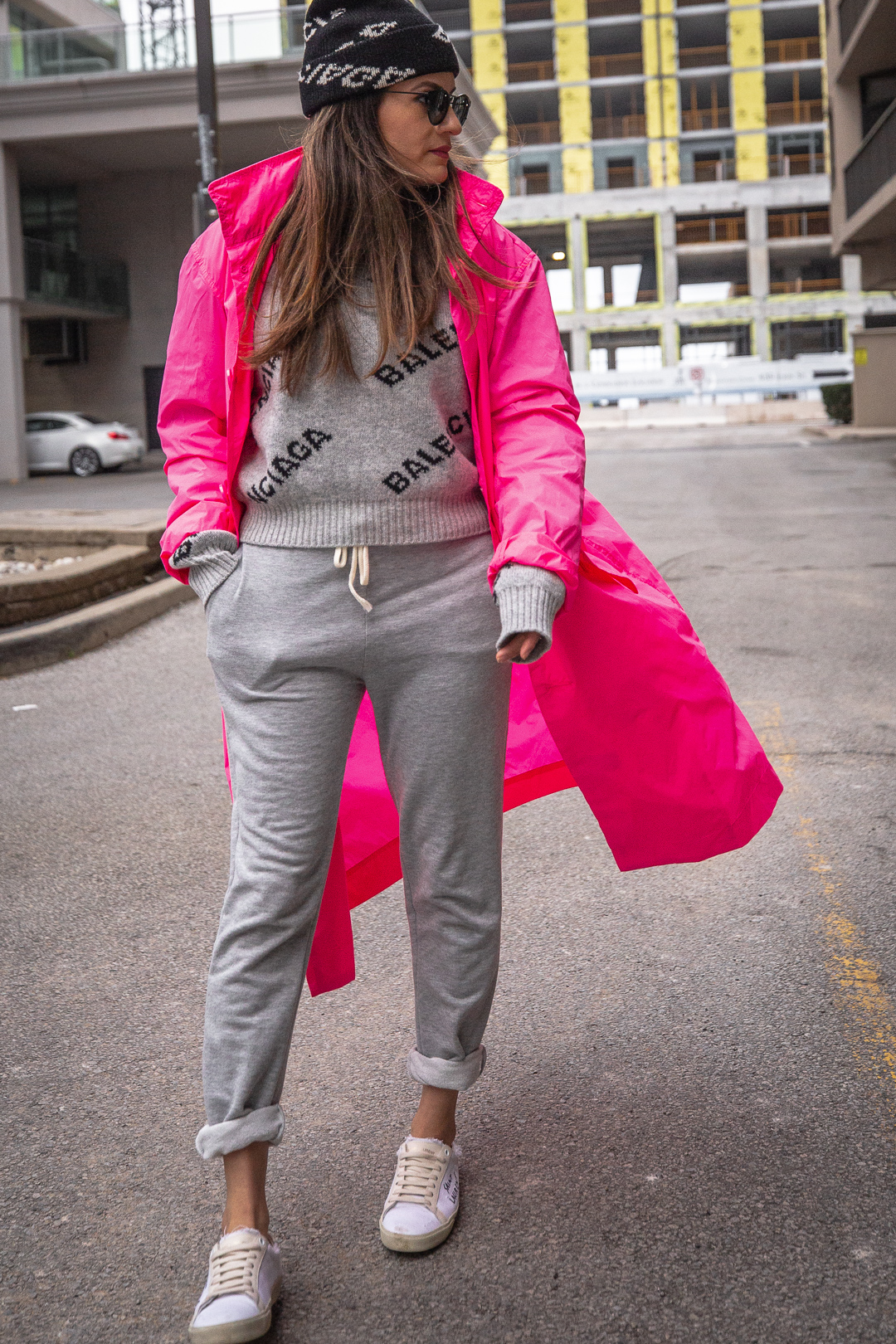 Nathalie Martin - Opening Ceremony pink nylon trench, Saint Laurent white canvas sneakers, Balenciaga logo beanie and cropped logo sweater, grey joggers, casual street style, woahstyle.com_5443.jpg