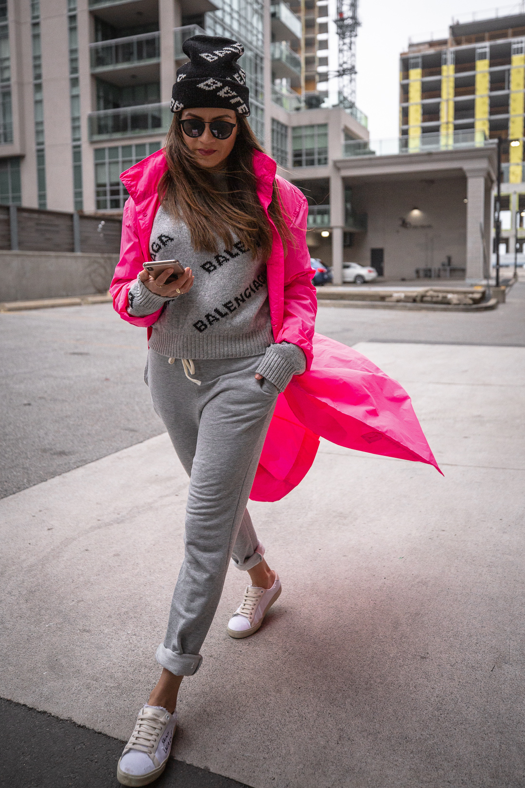 Nathalie Martin - Opening Ceremony pink nylon trench, Saint Laurent white canvas sneakers, Balenciaga logo beanie and cropped logo sweater, grey joggers, casual street style, woahstyle.com_5438.jpg