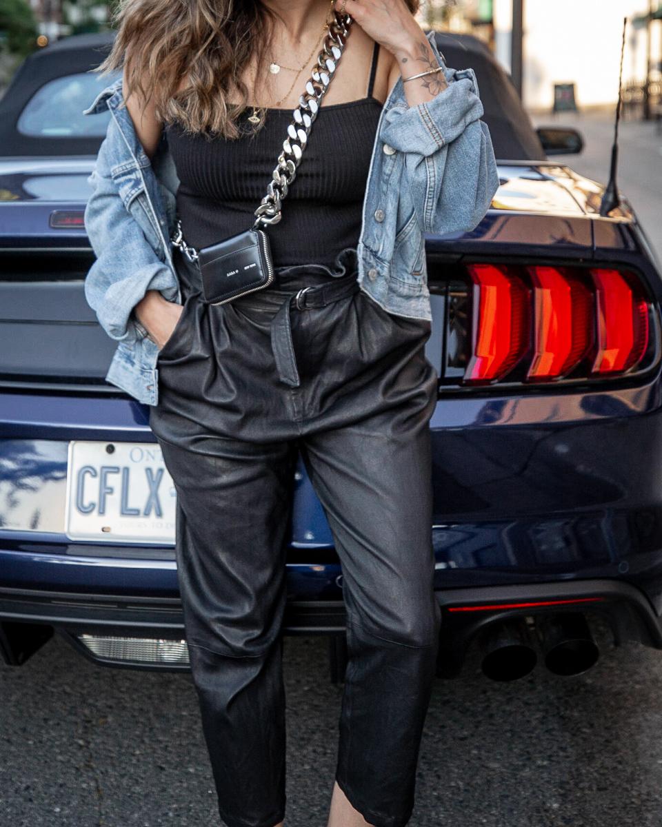 nathalie martin - Kara Biker Wallet on a chain, leather pants, madewell oversized denim jacket, black bodysuit, birkenstocks, street style, woahstyle.com_0136.jpg
