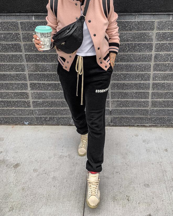 Instagram @_NathalieMartin - casual outfit ideas, Essentials black jogger sweatpants, jogging pants, Saint Laurent white canvas high top shoes, pink Saint Laurent Teddy jacket, Louis Vuitton Empreinte Bumbag, woahstyle.com_6532.JPG