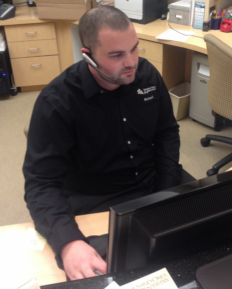 Our office manager, Michael. hard at work taking phone calls.