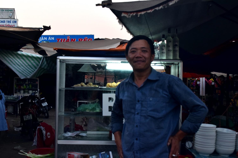 Man at the night market in Ea Drang