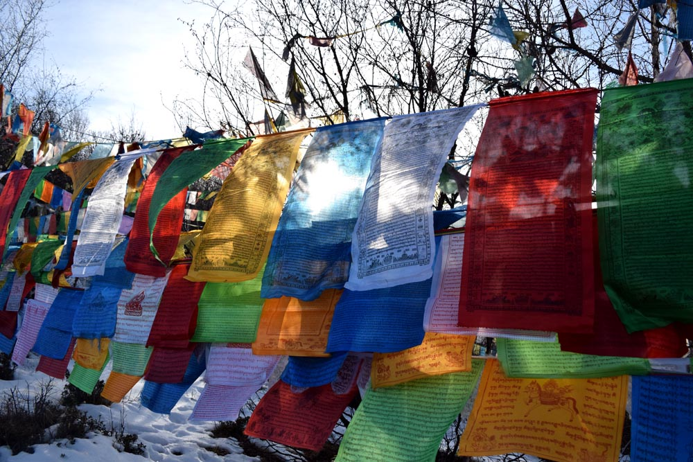 In Buddhism, wishing is like praying and these colorful flags represent prayers as they blow in the wind until they disintegrate with time.