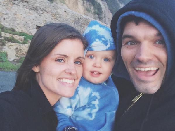 Happy family and indigo dyed baby clothes. Image courtesy of Liz Spencer.