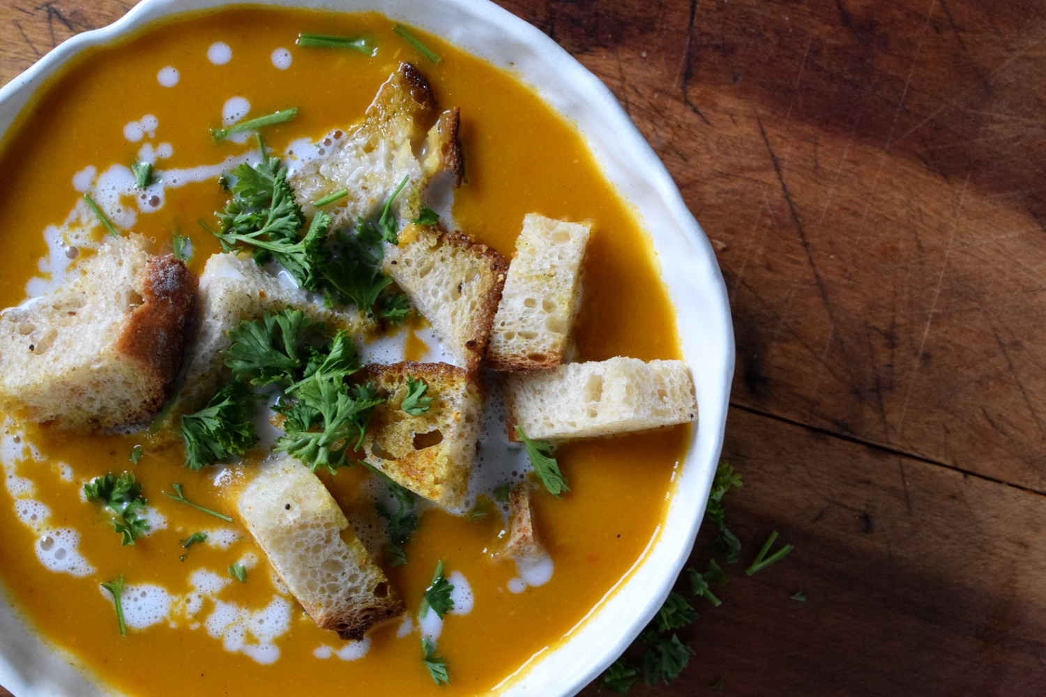 sweet carrot ginger soup with vegetables from local roots csa by sustaining life