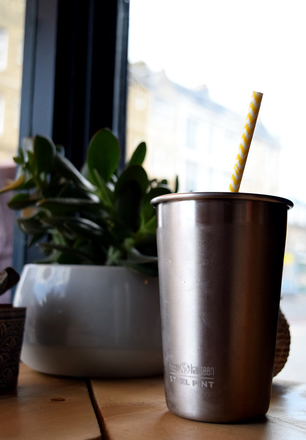 Klean Kanteen reusable cup in action with a fun paper straw.