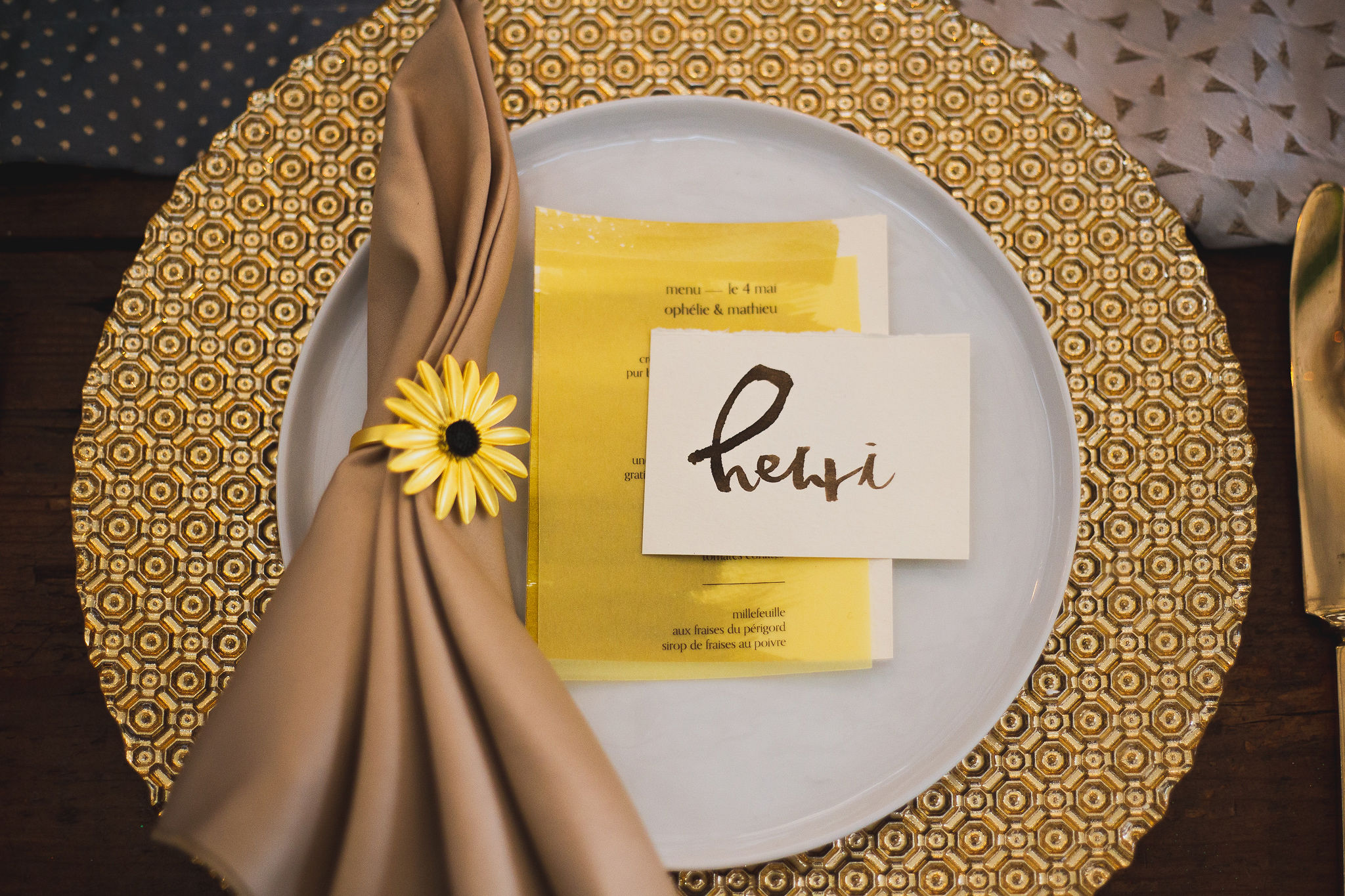 watercolor place card with daisy napkin ring and gold charger and gold vintage flatware with vellum printed menu.jpg