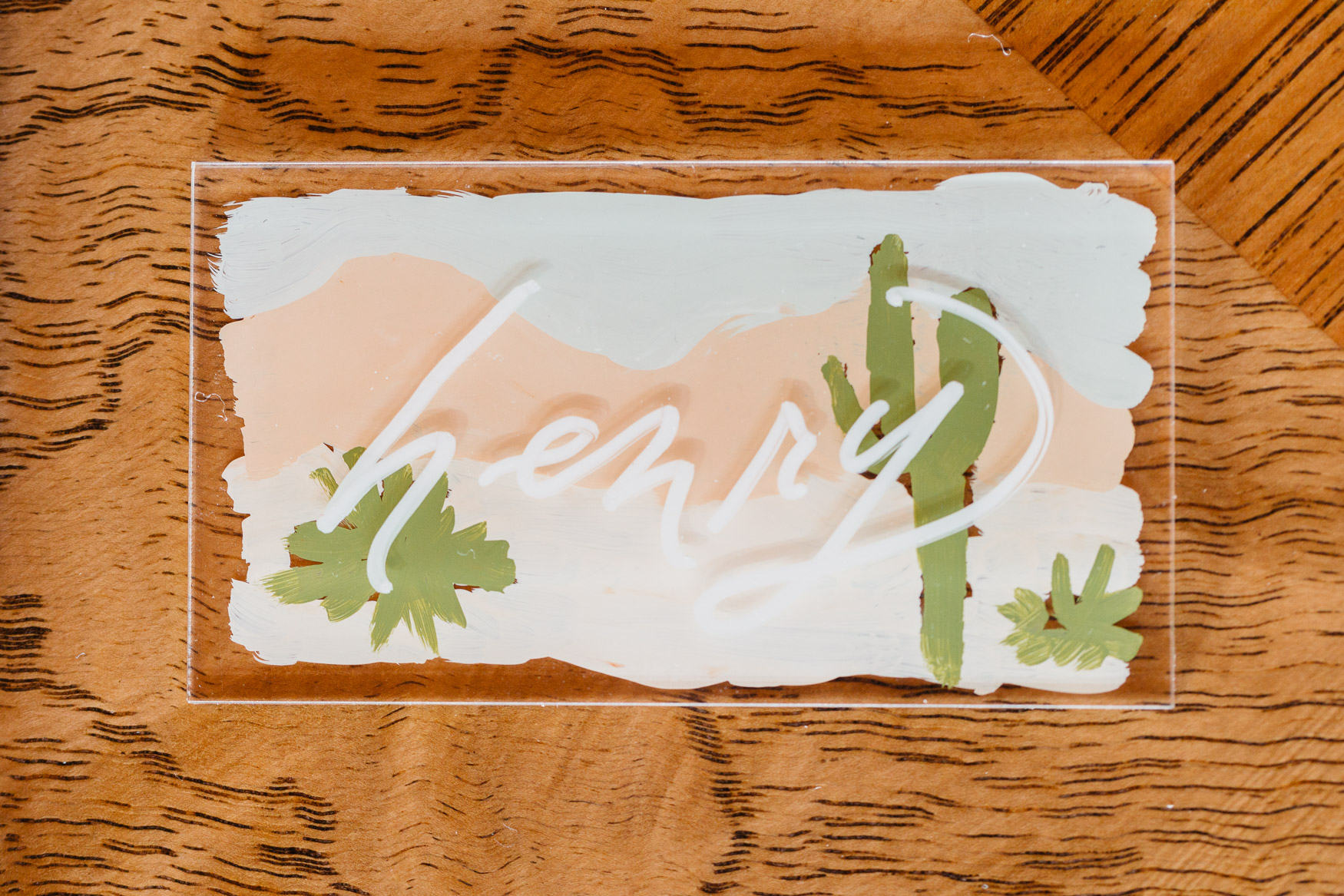 illustrated desert scene on acrylic place card with handlettered name on farm table.jpg