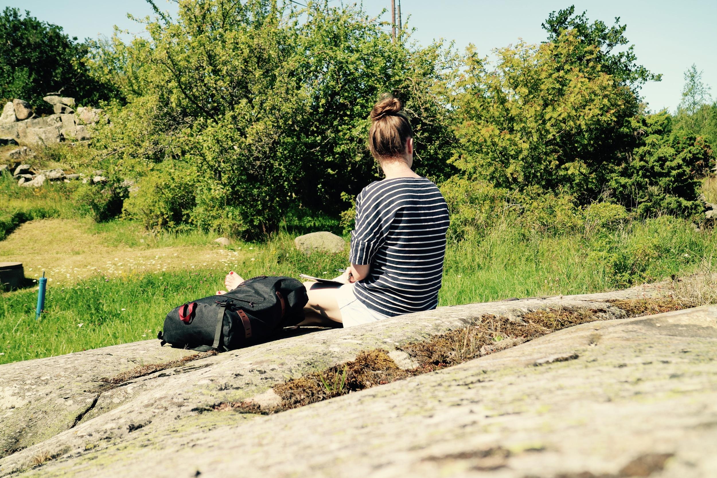 SITTING ON ROCK.jpg