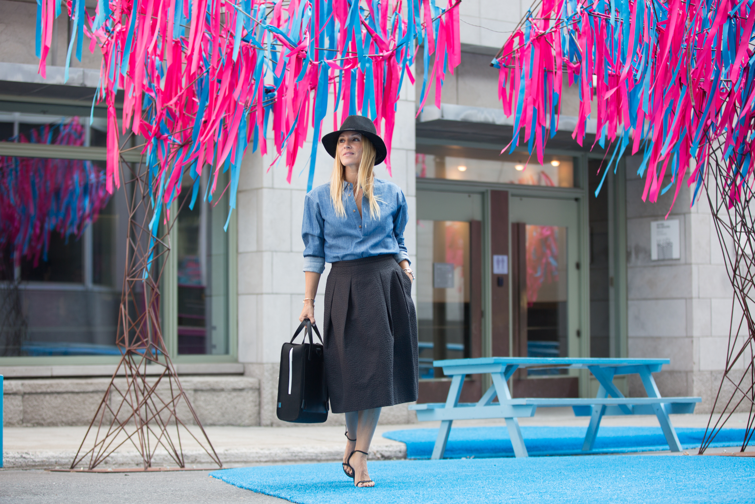 mademoiselle jules wearing a Publish denim shirt from Ben & Boule trading with a midi skirt and MRKTBAG and Stuart Weitzman nudist sandals