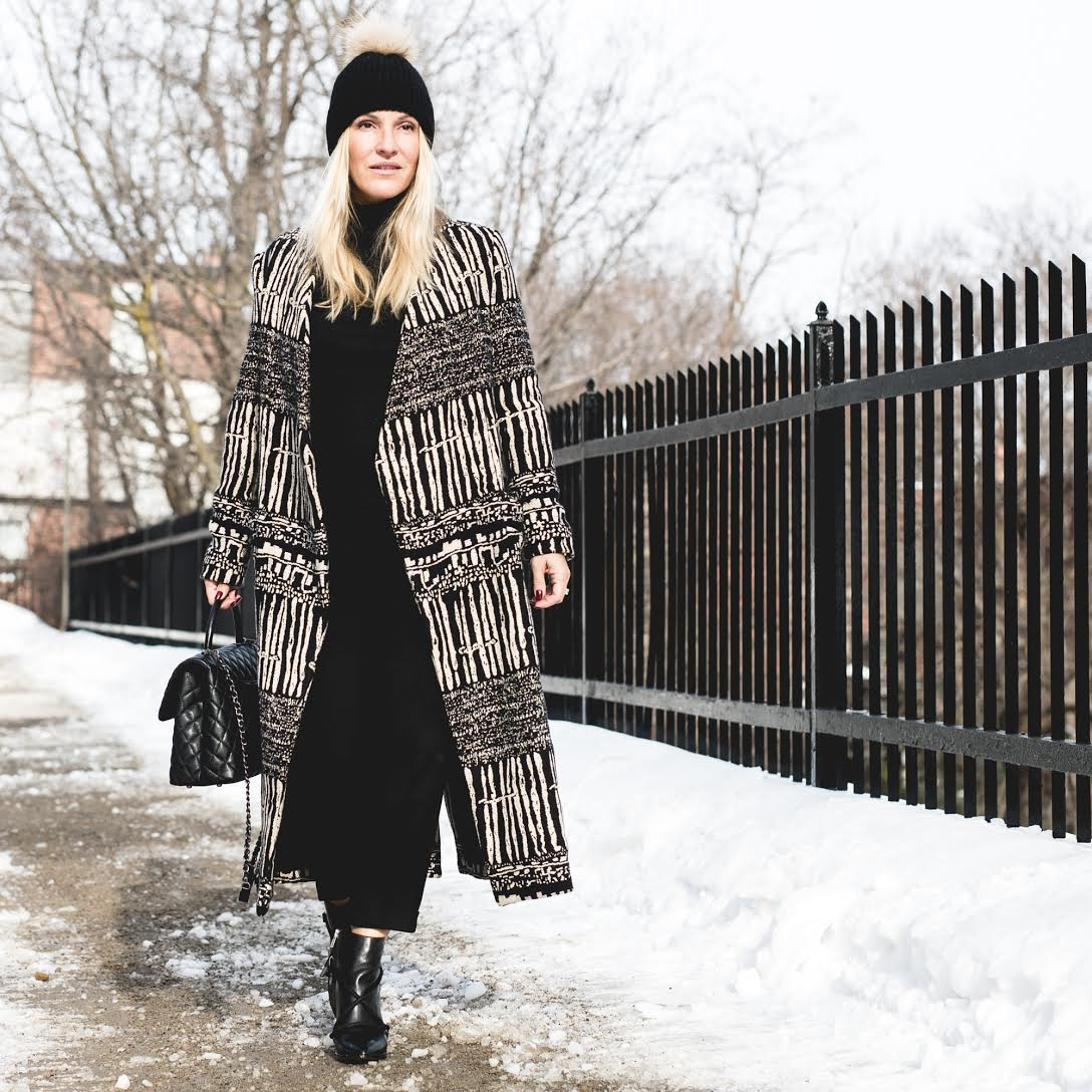 Look #2: Coat & Boots: Iro Paris, Hat: Lysa Lash Fur, Bag: Chanel   Photography by  Patricia Brochu