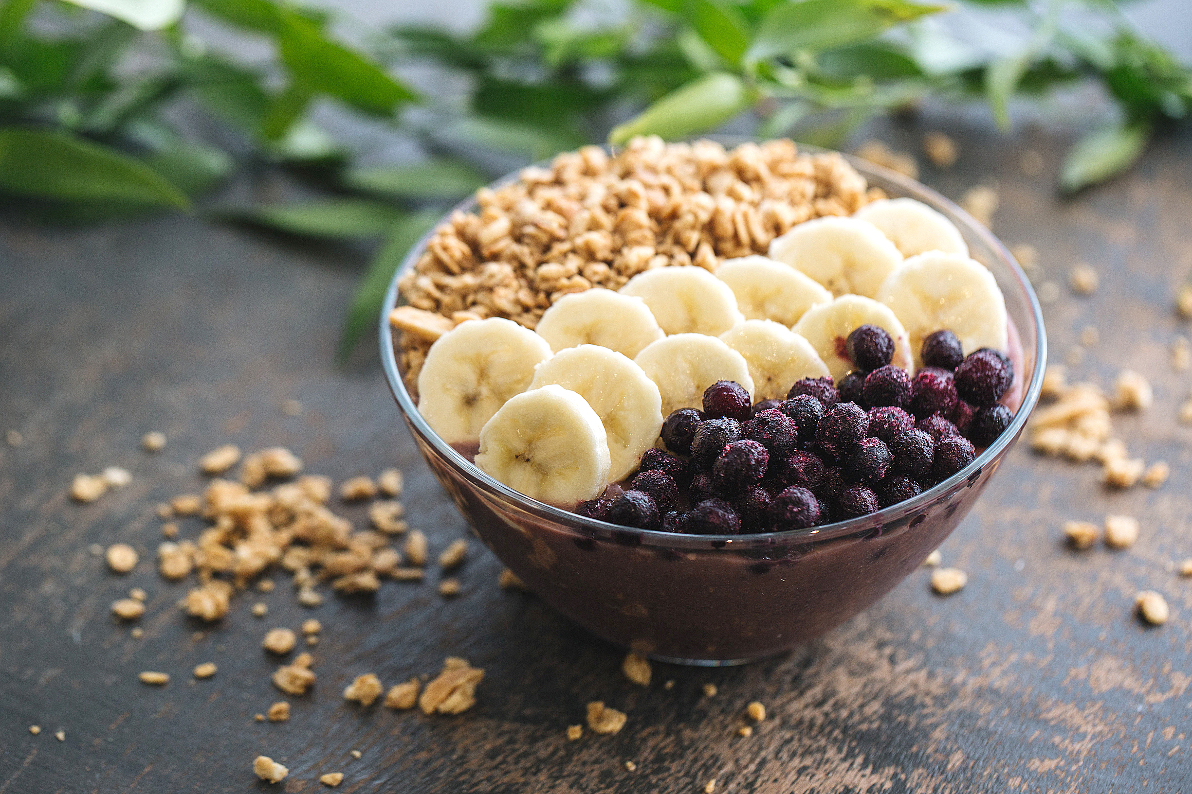 Almond butter açai smoothie bowl: açai, banana, pineapple, almond milk – topped with blueberries, granola, shredded coconut and almond butter