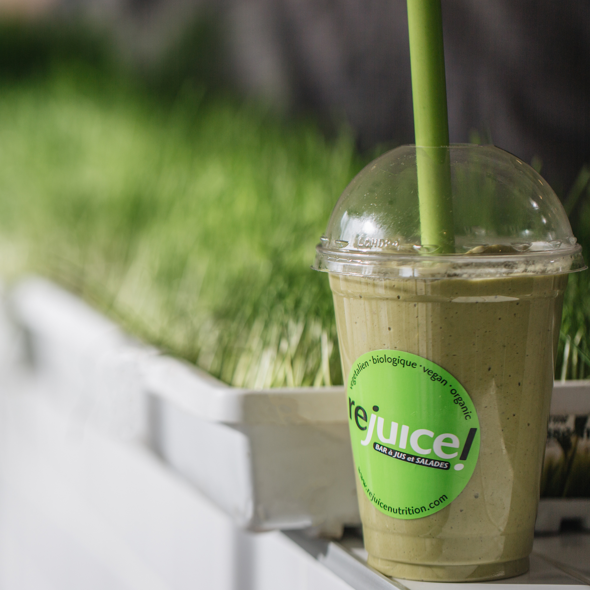 Avo-Colada smoothie perfectly blended with avocado, pineapple, banana, spinach, coconut water, vanilla, and lime