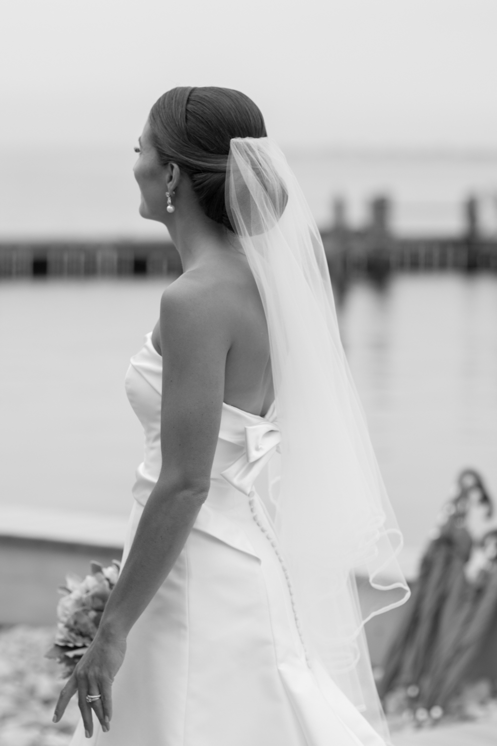 Low chignon bun: a simple but timeless style for the classic bride.