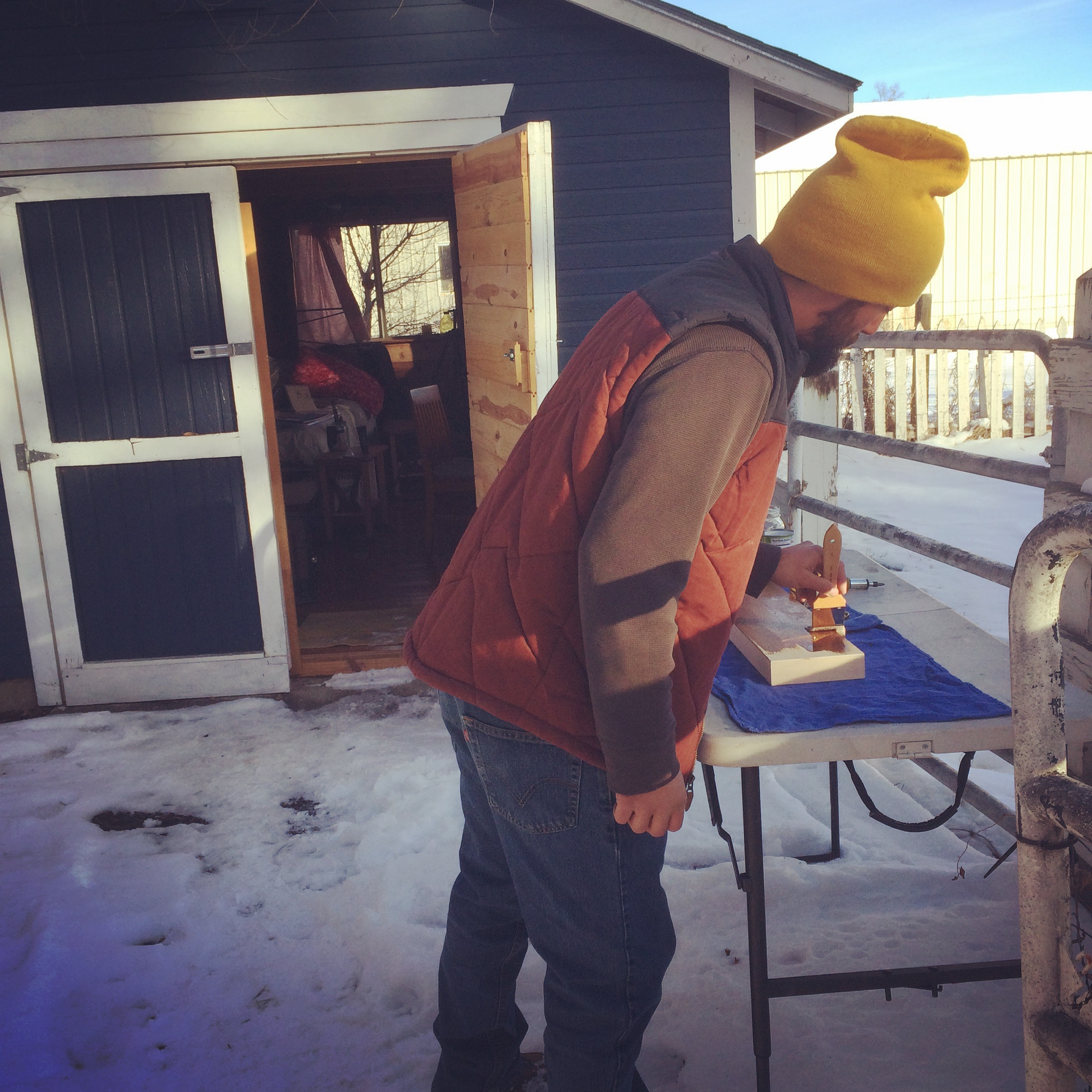Applying stain to a fresh panel outside of The Shed.  |  Laporte, CO