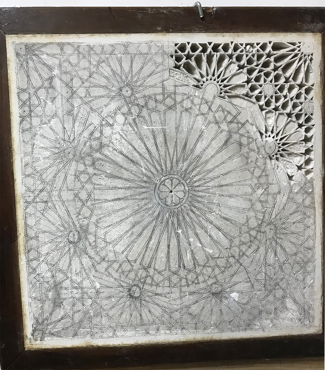 A complex pattern drawn on plaster with only a compass and ruler