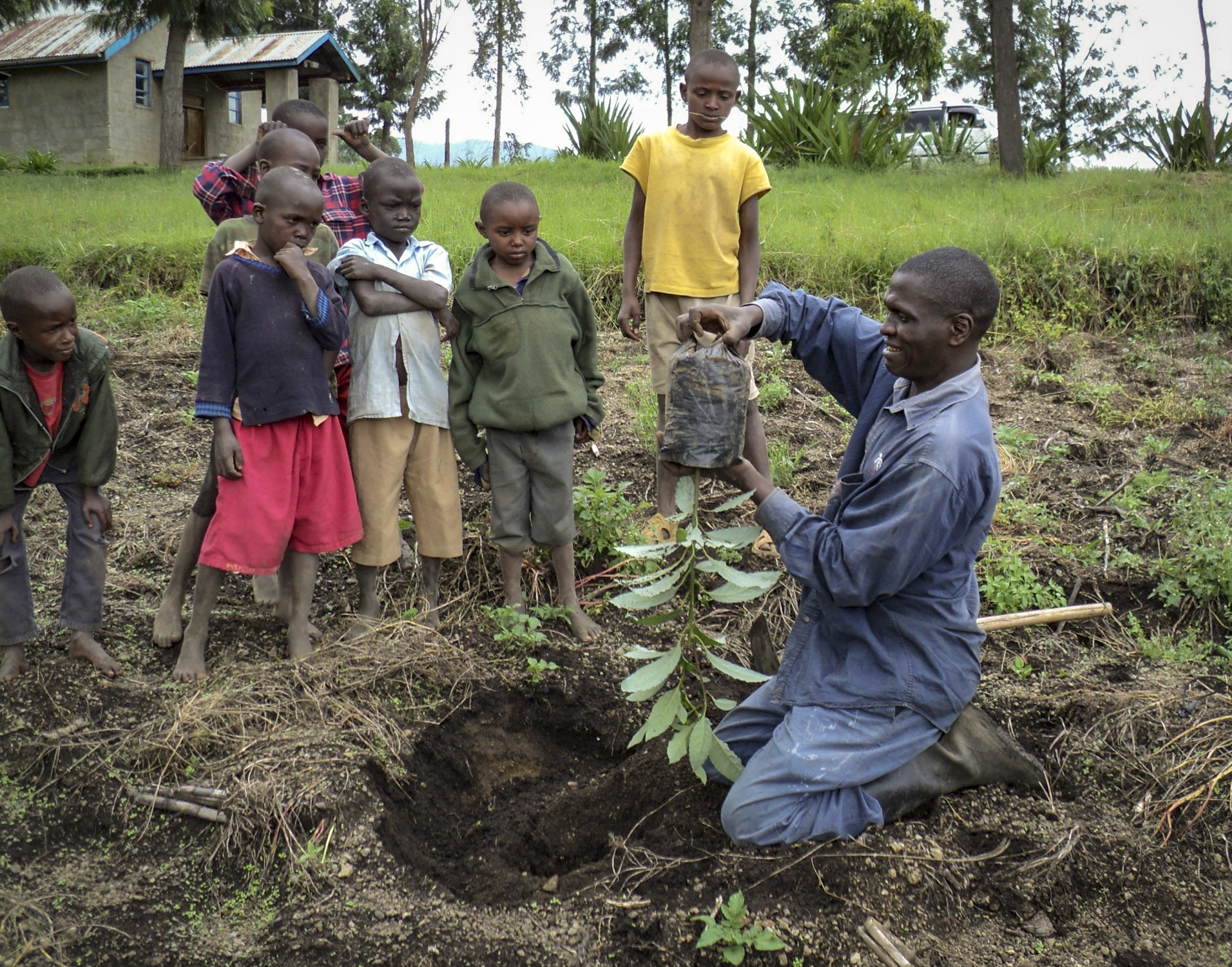 Jopsaht demonstrates how to plant a tree seedling-1.jpg