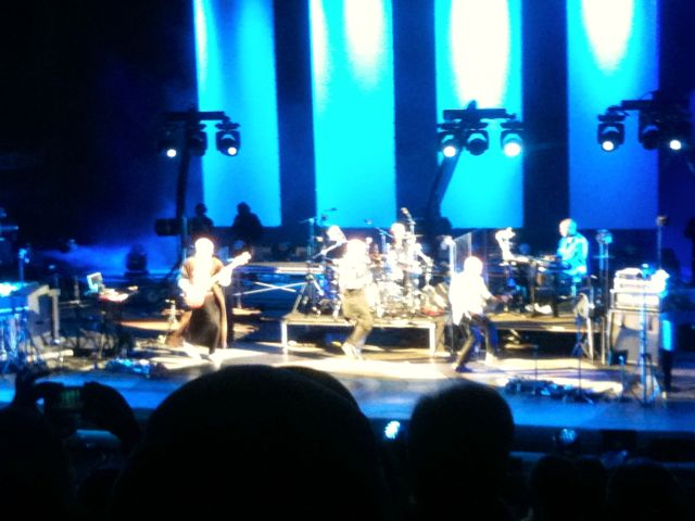 Peter Gabriel is quite the showman and employs choreographed dances with his band members as part of his performance.