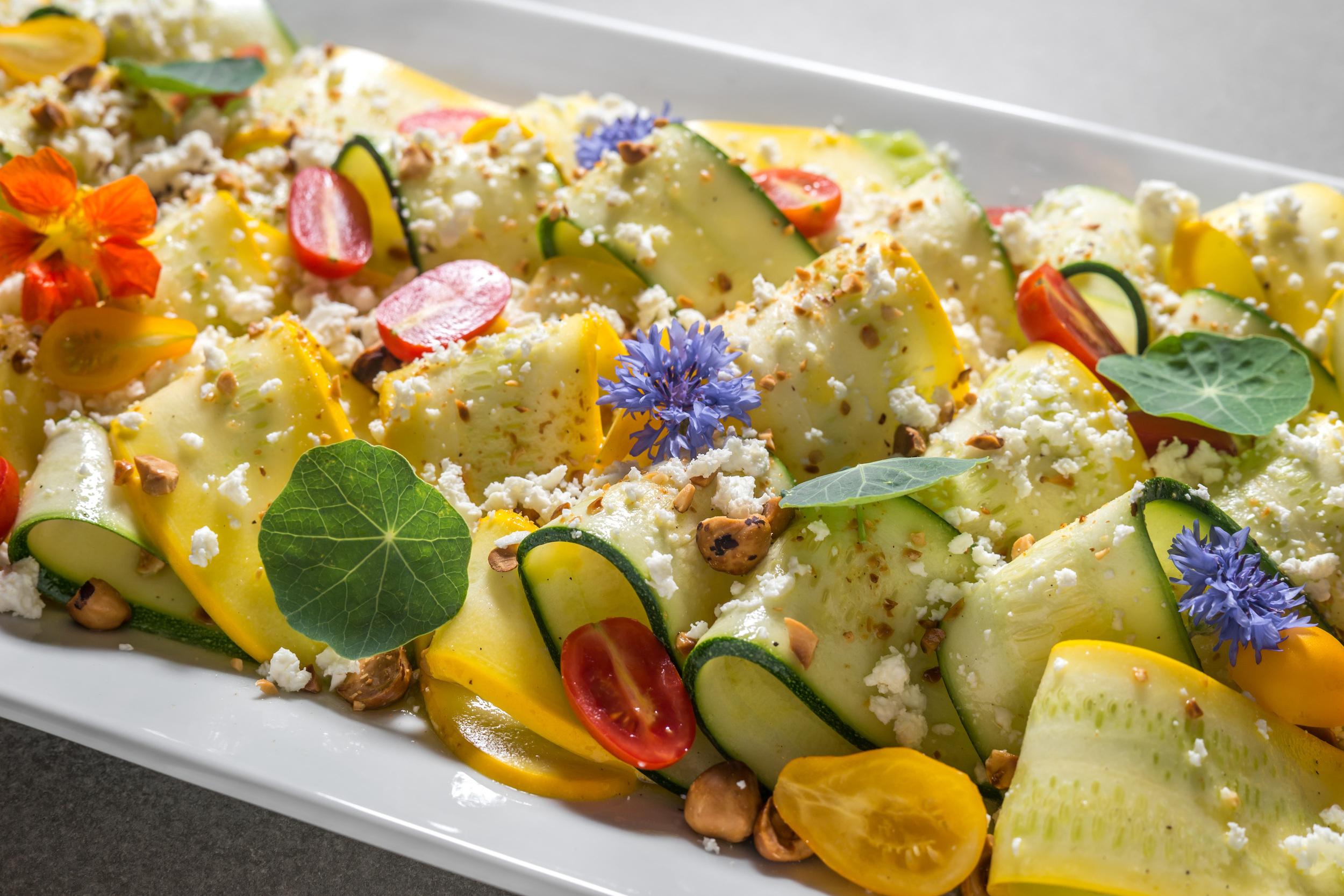Summer squash salad with feta and hazelnuts