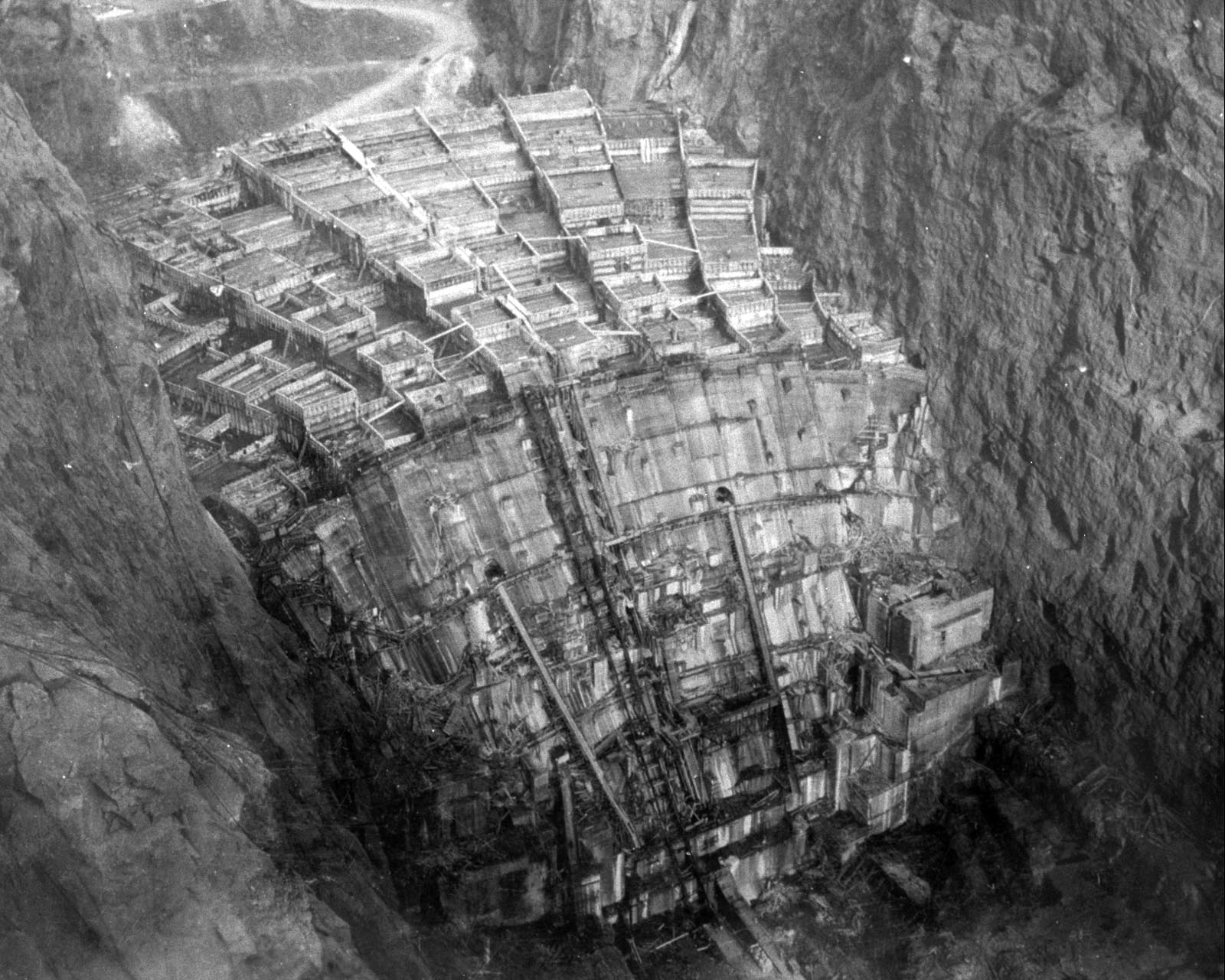 "WASH-No-2332: ""The dam structure as seen from the control tower of the 150-ton cableway on the NV rim of Black Canyon. Top forms at Elev. 795. - USBR"