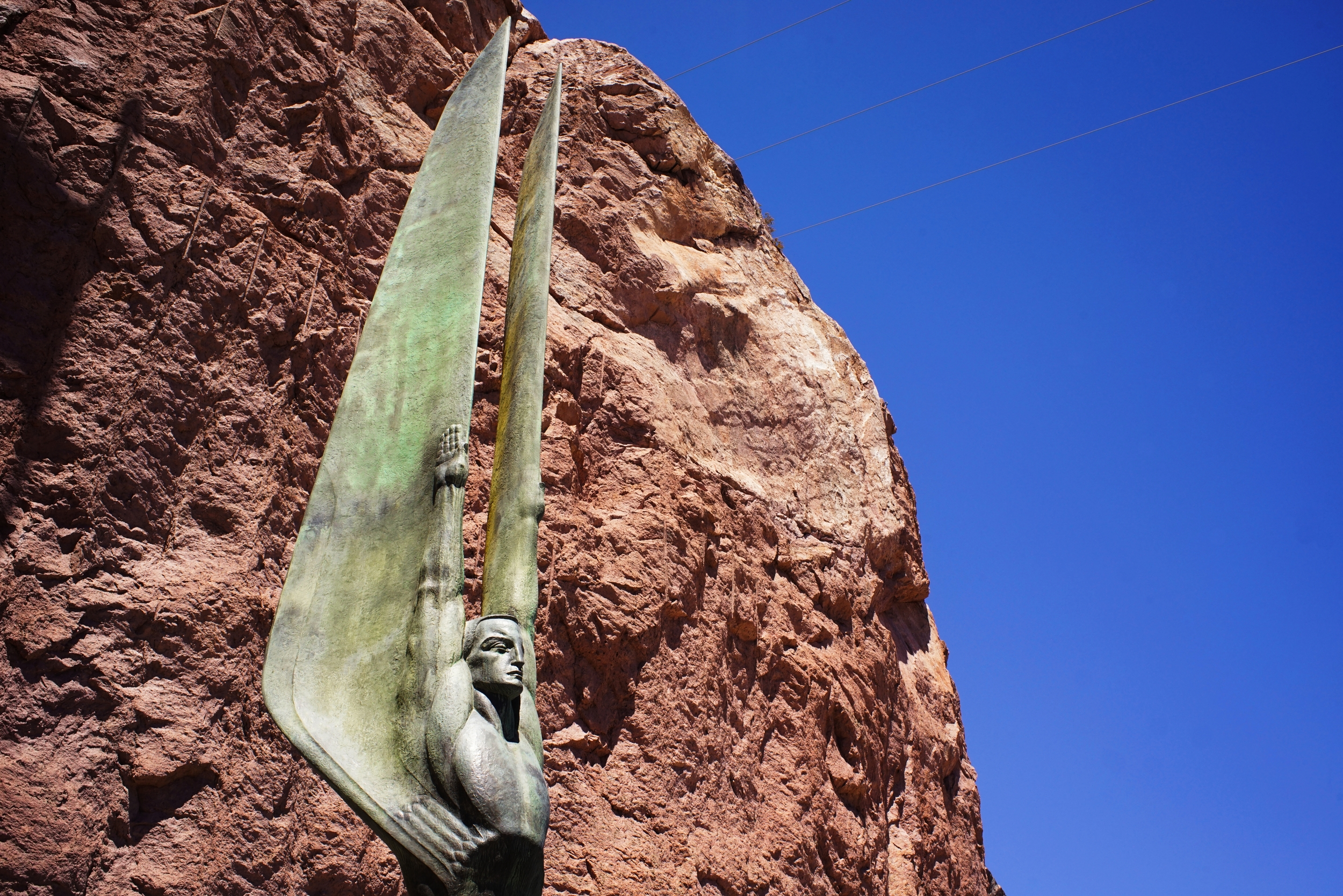 A side view of one of the two  Winged Angels of the Republic  standing tall next to the canyon walls.  Photo: Trey Takahashi