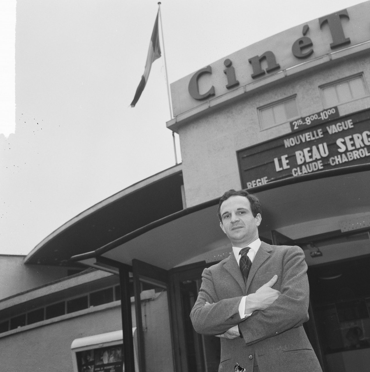 François Truffaut stands outside of cinema showing Charbol's  Le Beau Serge , one of the first New Wave films.
