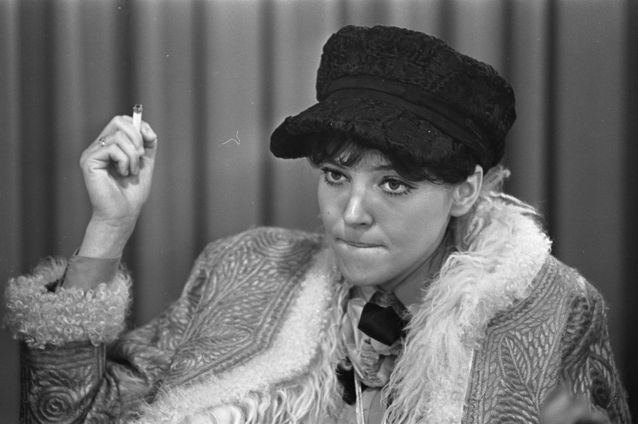 Anna Karina, starlet of many of Jean-Luc Godard's film appearing in  Le Petit Soldat .