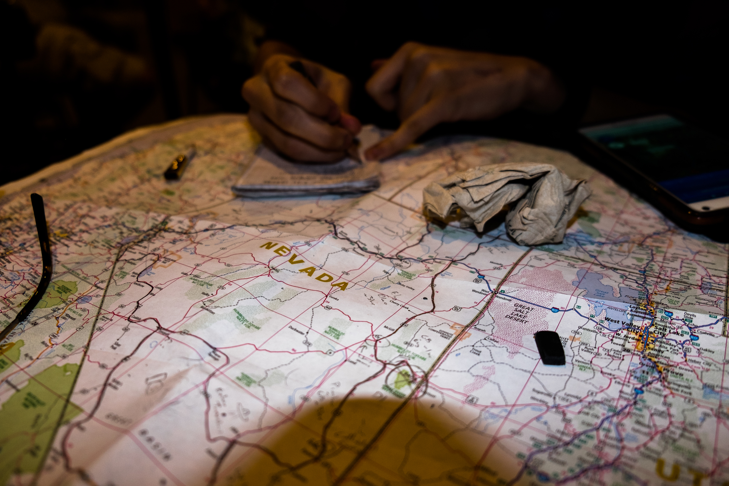 Planning the trip on a road map of the Western states.